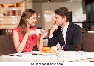 Loving couple having romantic breakfast at the restaurant...
