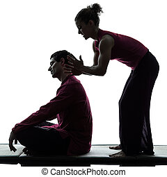 thai massage silhouette - one man and woman performing thai...