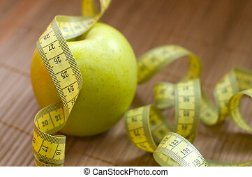 Apple and metric ribbon, symbol for diet and healthy...