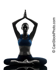 woman exercising yoga meditating sitting hands joined