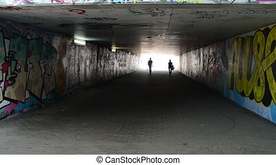 silhouette passage - People silhouette man and woman walk in...