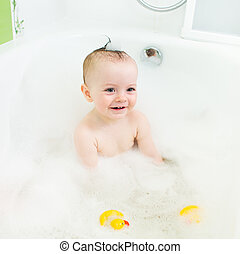 smiling baby taking bath
