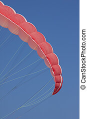 Paraglide - a red paragliding on air with blue sky...