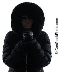 woman winter coat freezing cold silhouette - one woman in...