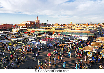 Djemaa el Fna market in Marrakesh, Morocco, with Koutubia...