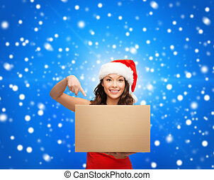 smiling woman in santa helper hat with parcel box -...