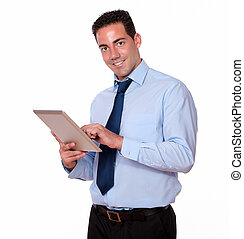 Handsome person using his tablet pc - Portrait of a handsome...