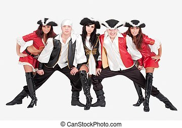 Young dancers in pirate costumes on a gray background