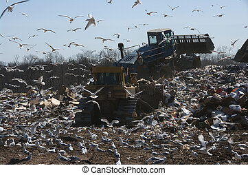 Landfill work - Working on a landfill, the pile is getting...