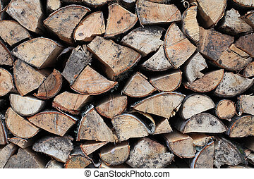 Woodpile - Woodpile of birch firewood close-up illuminated...