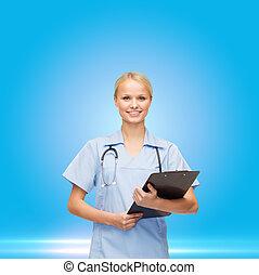 female doctor or nurse in mask holding syringe - healthcare...