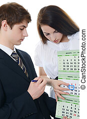 The businessman and businesswoman hold calendar - The...