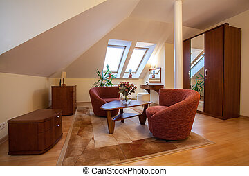Attic - Wooden furniture in living room on the attic