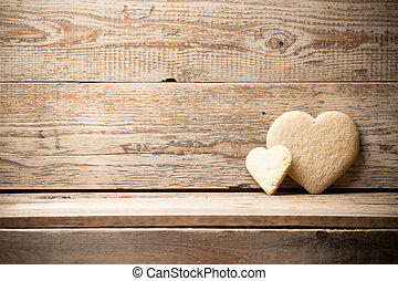 Heart. - Heart-shaped biscuit on wooden background.