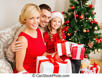 smiling family holding many gift boxes - family, christmas,...