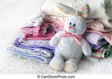 Pile of baby clothes - Lot of different baby clothes for the...