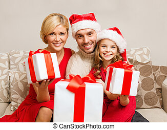 smiling family giving many gift boxes - family, christmas,...