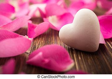 Rose petals. - Rose petals and stone hearts.