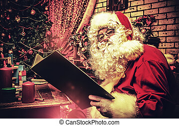 reading fairytales - Santa Claus reading fairytales at home....