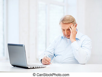 old man filling a form at home - business, tax, office,...