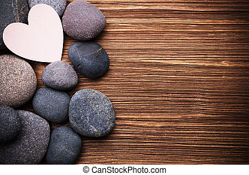 Spa stones. - Spa stones in te wooden background.