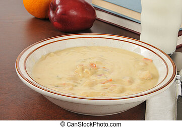 Cheesy chicken soup - A bowl of chicken con queso soup with...