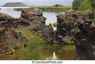 Lake and lava formations in Myvatn Iceland - Geological...