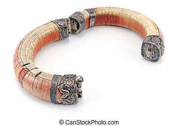 Open ivory bracelet isolated on white