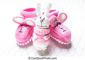 Knitted baby booties - Knitted pink baby booties with rabbit...