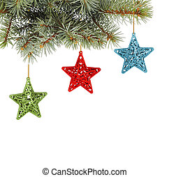 Christmas fir branch with   multicoloured, stars on a white background isolated