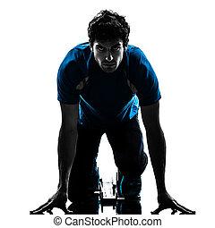 man runner sprinter on starting blocks silhouette - one...