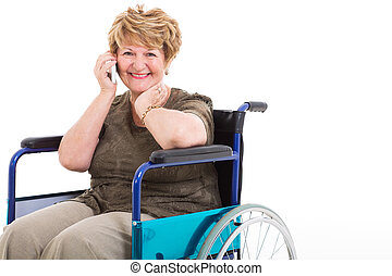 disabled senior woman talking on cell phone - cheerful...
