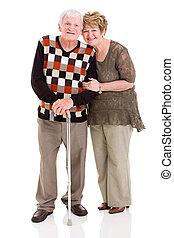lovely senior couple isolated on white background