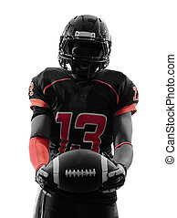 american football player standing holding ball silhouette -...