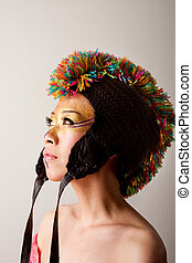 Colorful mohawk hat - Beautiful Asian female face with a...