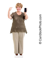 mature woman pointing at smart phone