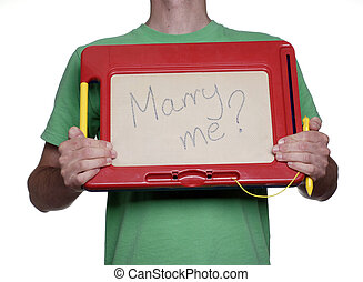 Marriage proposal - Man holding magnetic drawing board with...