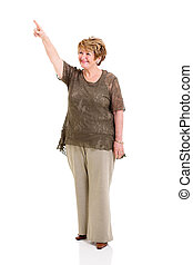 senior woman pointing up - smiling senior woman pointing up...