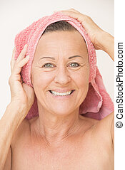 Happy naked mature woman with towel - Portrait happy...