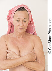 Sad mature woman hands on breasts - Portrait attractive...
