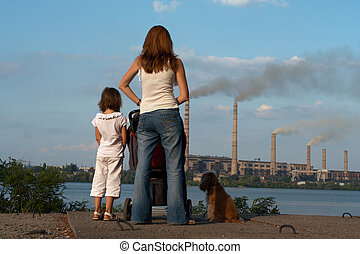 looking at the chimney-stalks - care future concept. Young...