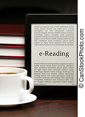 eReading - eReader, cup of coffee and pile of traditional...