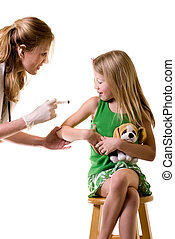 Child getting a vaccine - Female nurse or doctor holding a...