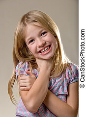 Happy eight year old girl - Portrait of cute blond little...