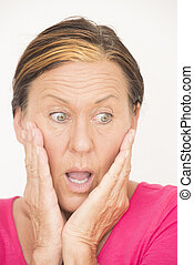 Shocked and worried woman - Portrait attractive mature woman...