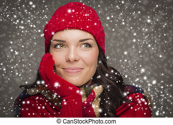 Happy Mixed Race Woman Wearing Winter Hat and Gloves Enjoys...
