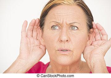 Worried shocked woman listening - Portrait attractive senior...