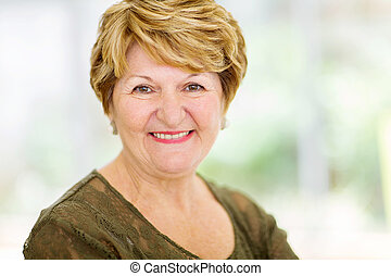 senior woman closeup portrait - cheerful senior woman...
