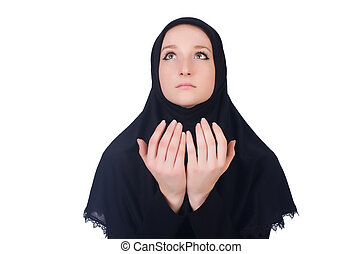 Young muslim woman praying isolated on white