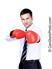 Business man ready to fight with boxing gloves - isolated...